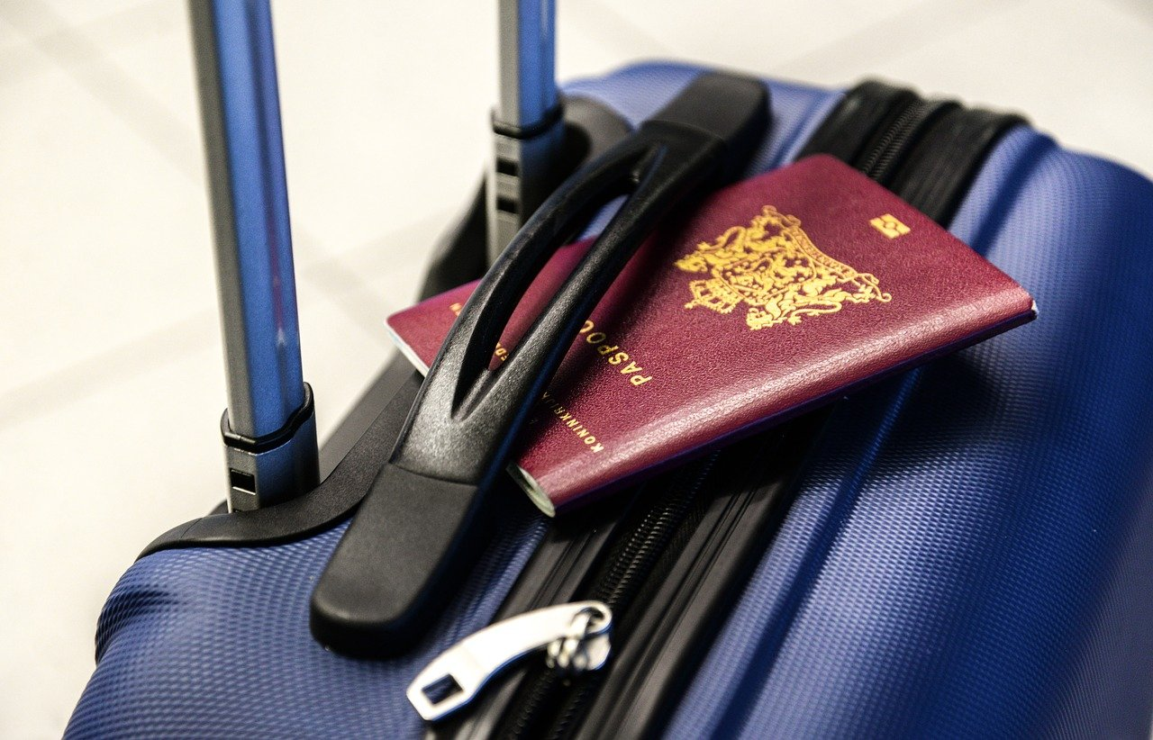 Passport on a blue suitcase